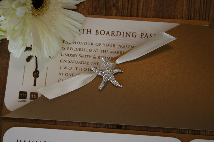A+ Gold Boarding Passes w/ Rhinestone Buckles, Ribbon These boarding pass invitations feature a unique gold metallic boarding pass jacket with your wedding invitation inside. The insert can be customized to the max.  25 pcs for $202.90