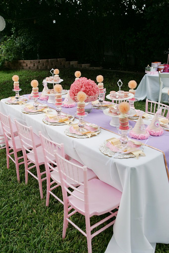 """We're beyond in love with this beautiful party table setup, which included spray-painted pink chairs. """"Spra..."""