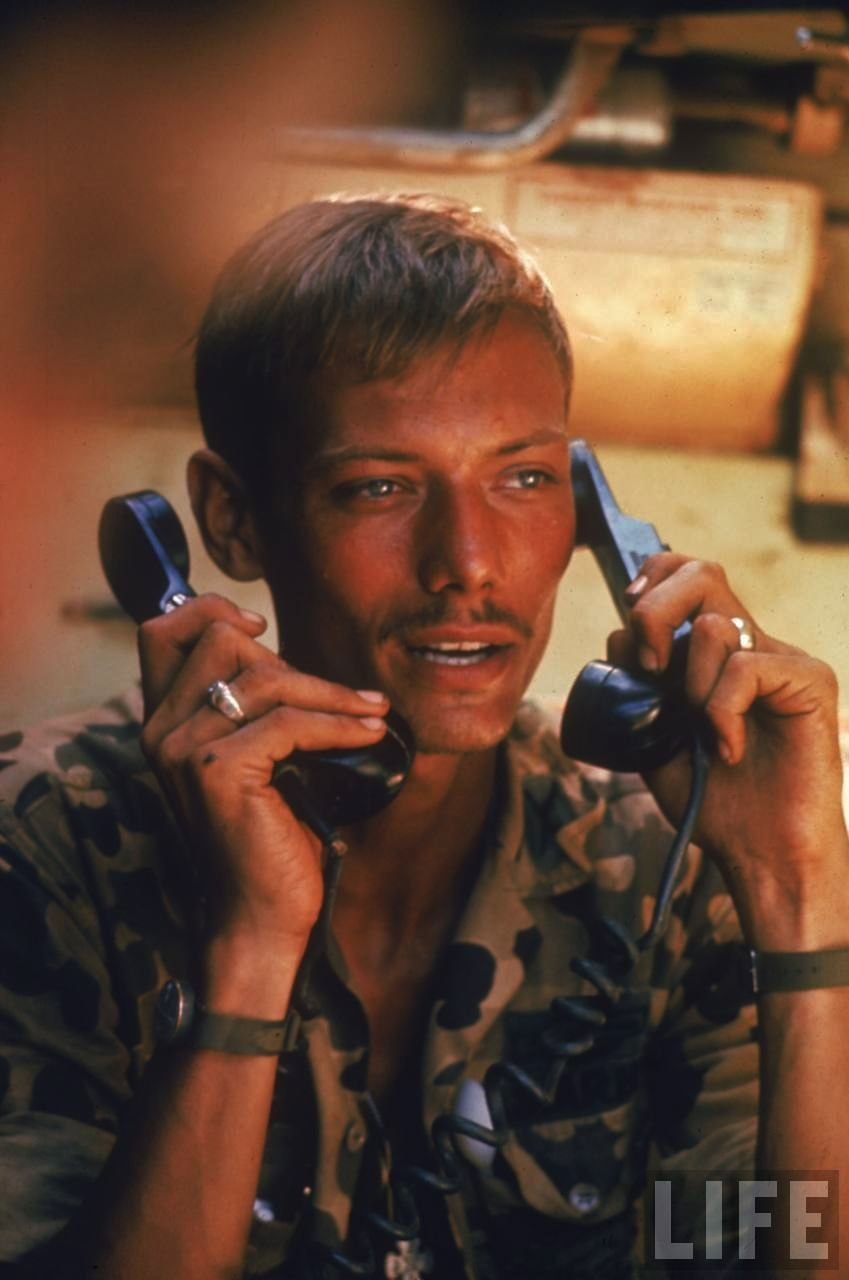 """""""American captain Dennis Muchlstedt working two phones while attempting to contact units of 9th Infantry who are on patrol in the South Vietnamese-Cambodian border area"""", by Larry Burrows, Vietnam, 1970 - Vietnam War"""