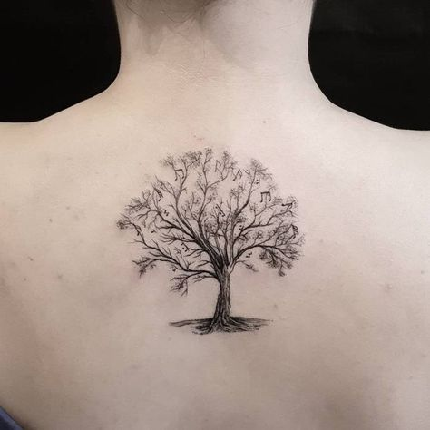 Upper Back Tree Tattoo with Musical Notes by Otavio Borges