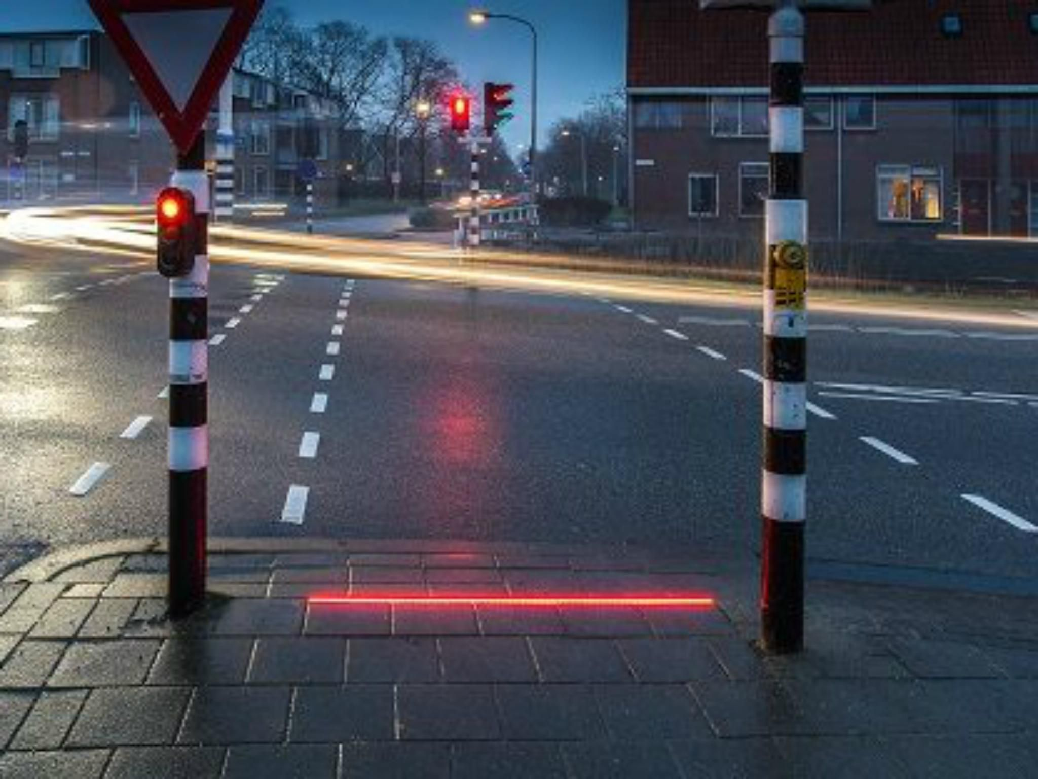 netherlands builds traffic lights in pavement for people who don t