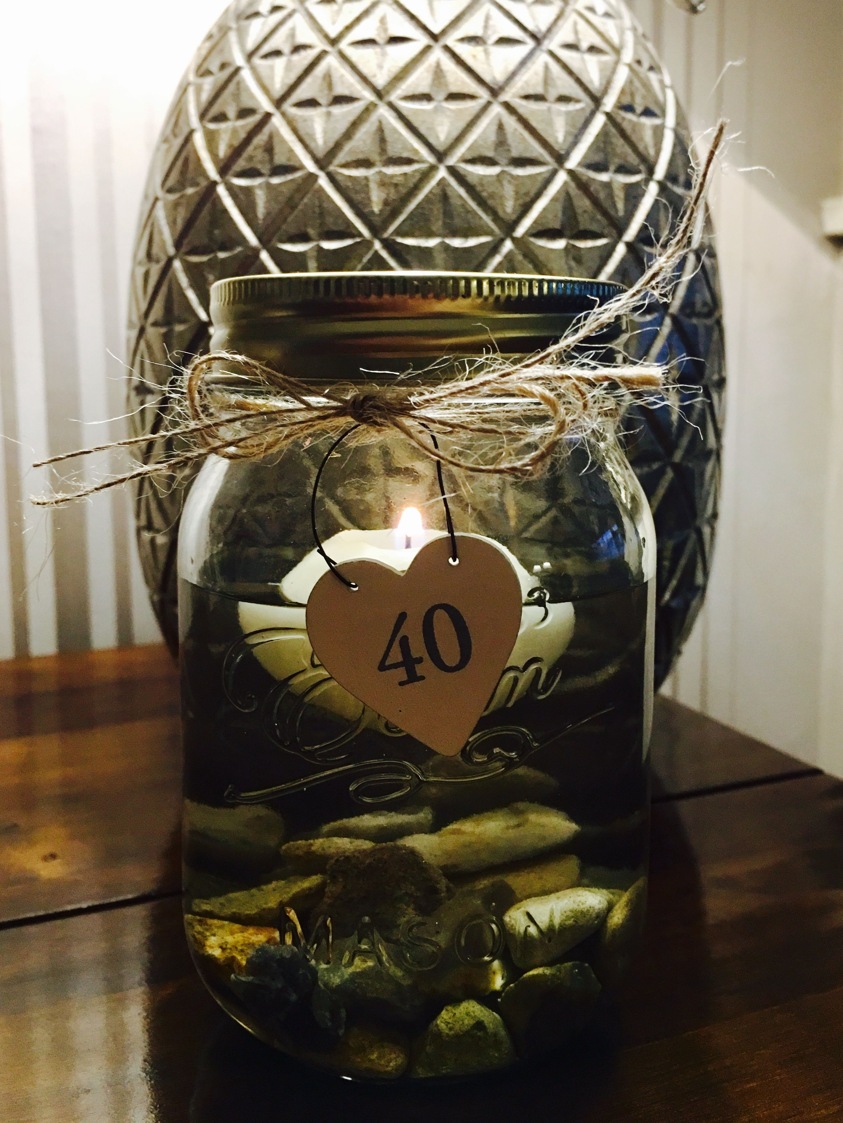 Table centrepieces th birthday party floating candle in a jar
