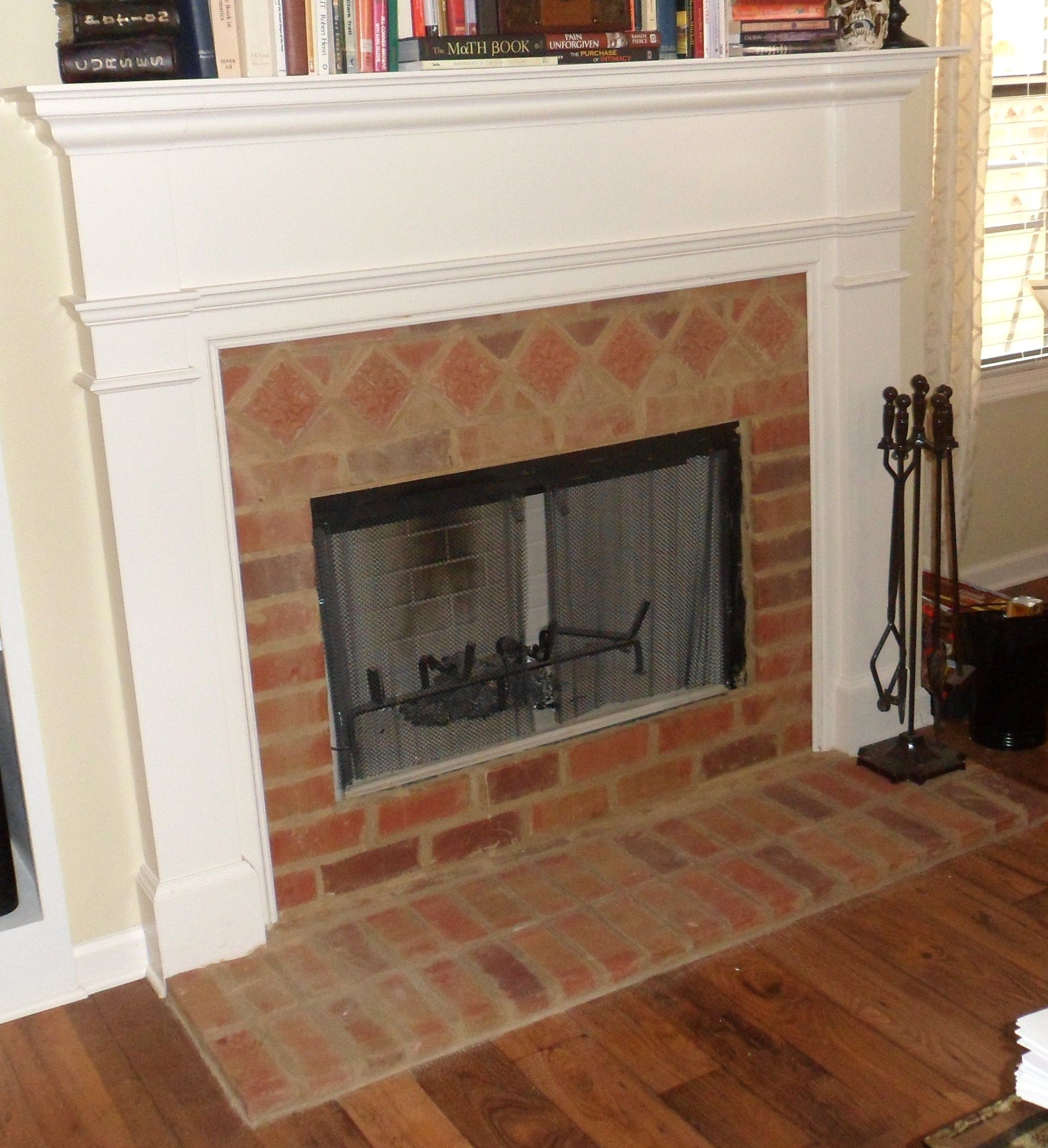 Lancaster Running Bond Tiles With Accent Tiles Were Used On The Hearth And Surround Of This Fireplace Fireplace Tile Brick Tiles Fireplace