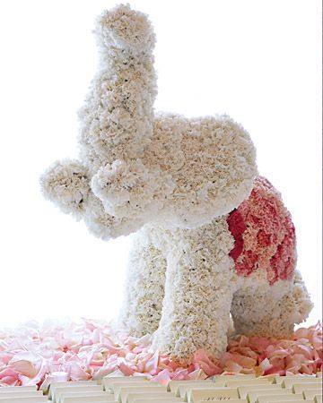 Love this whimsical elephant centerpiece, made of pink and white carnations