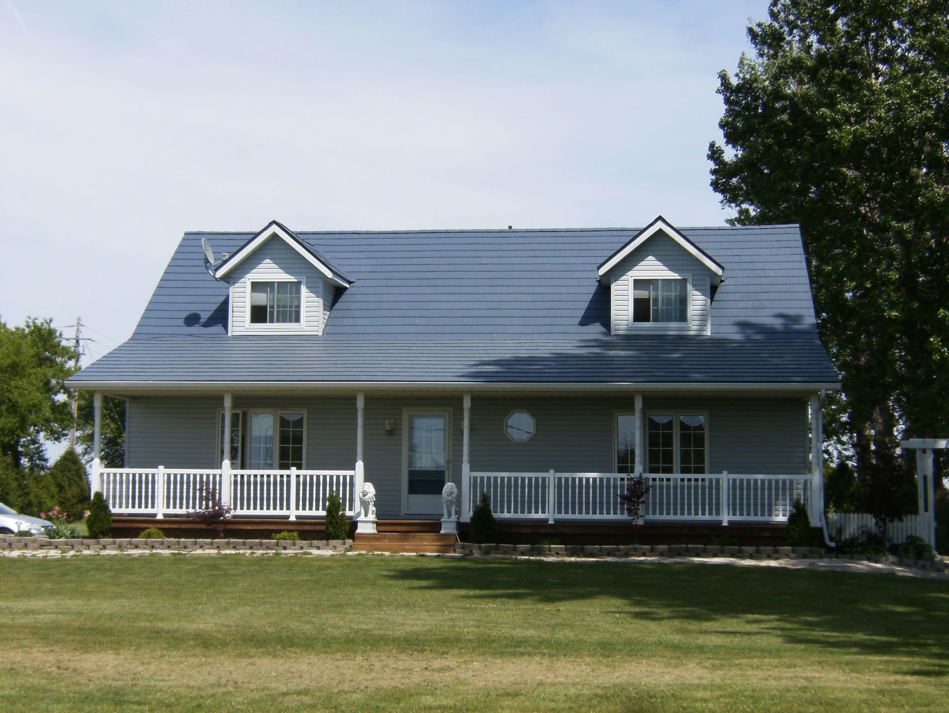 Gallery blue metal roof metal roofing ontario for Blue house builders