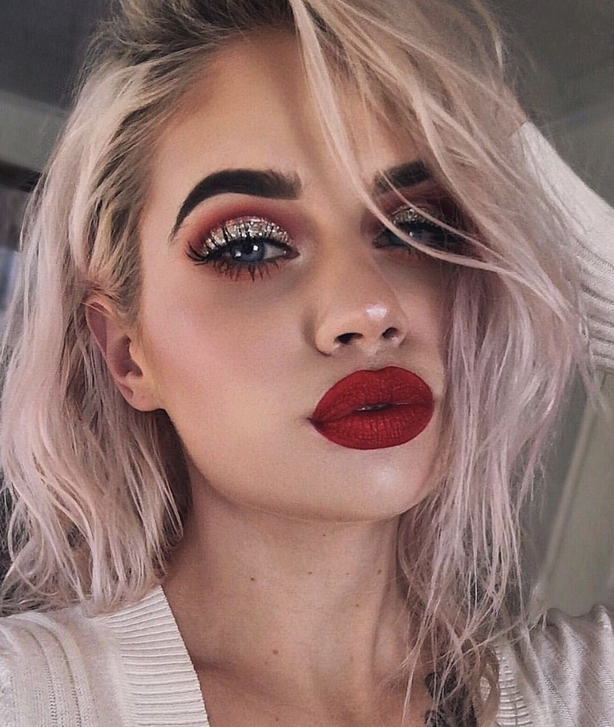 I can see her real lip line and her brows are too dark but this is