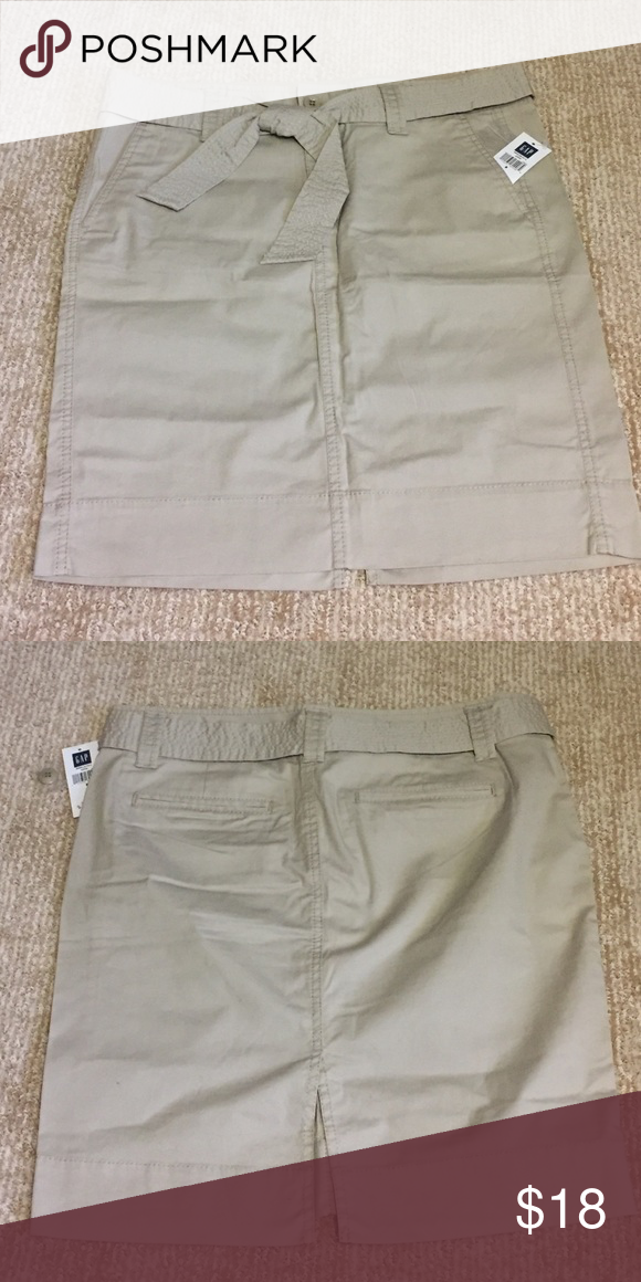 NWT military inspired khaki skirt GAP Sz 8 NWT light khaki skirt with button and zip closure, removable belt/sash and side pockets. Sz 8 GAP Skirts