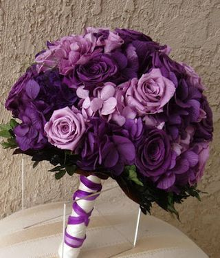 Smaller version for bridesmaid bouquet?  Or this for the bride and white for bridesmaids since they will be in purple?