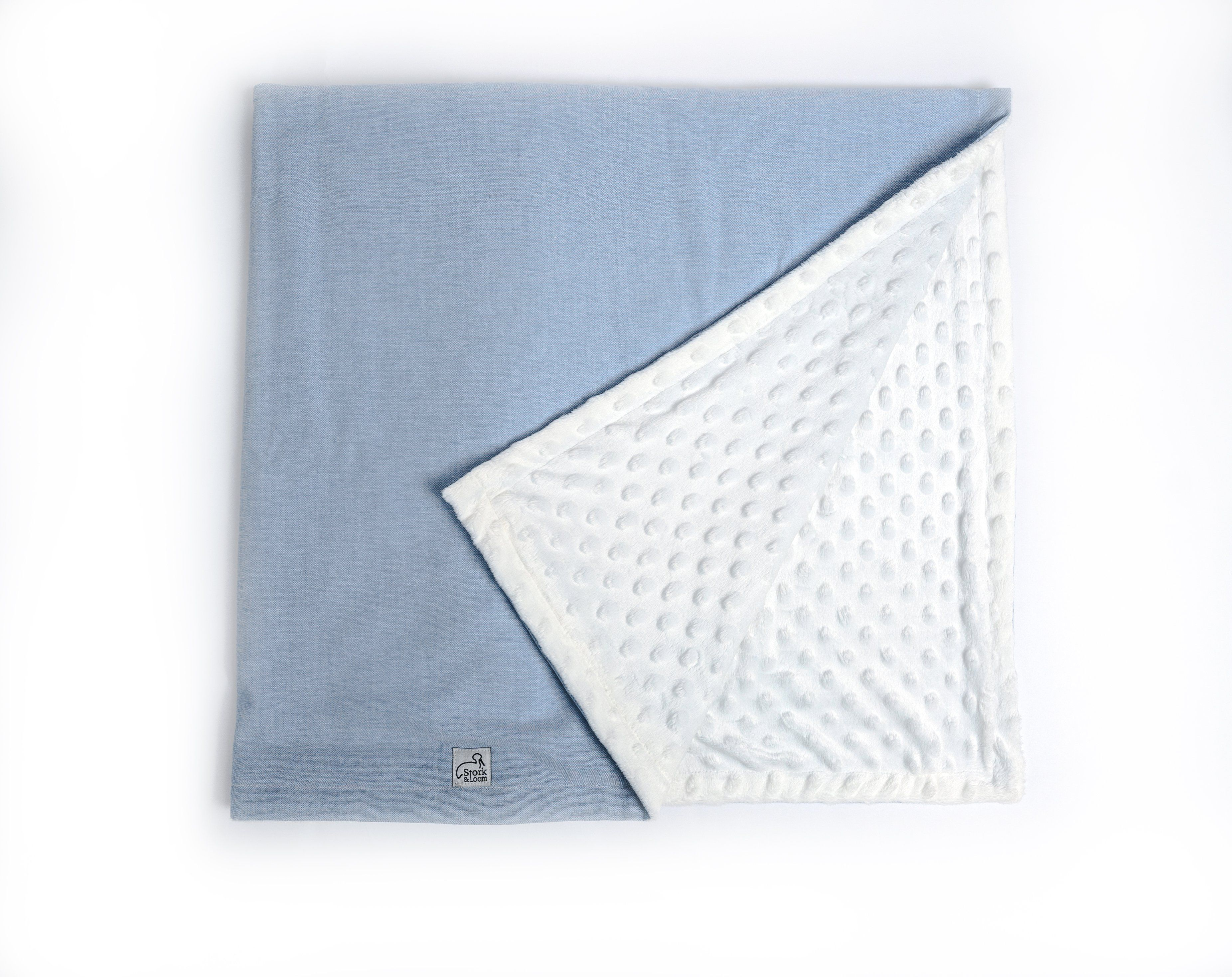 """Ultra-SoftOur blankets feature an ultra-soft minky dot backing that is comfortable for your baby and perfect for snuggling up. Perfect SizeOur blankets are just the right size for your baby meaning you don't have to worry about bulks of fabric and keeping your baby too warm. Stylish and ModernOur designs are cute, timeless, and modern making nap time even cuter than before. Materials: 100% polyester minky dot fabric, 100% cotton oxfordCare: Machine washable, do not bleachSize: 38"""" x 28"""""""