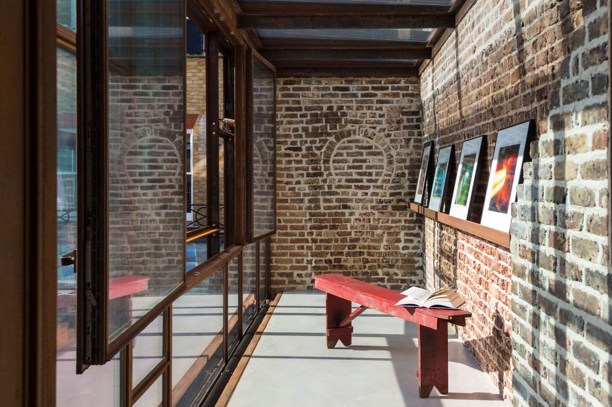 Corridor With Concrete Floor Large Windows Brick Walls And Pictures The Private Art Gallery In London By Gianni Botsford Architects