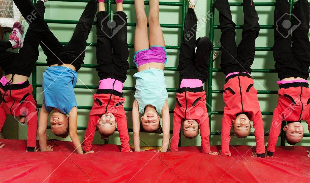 Sporty Kids Making Handstand Position In Gym Aff