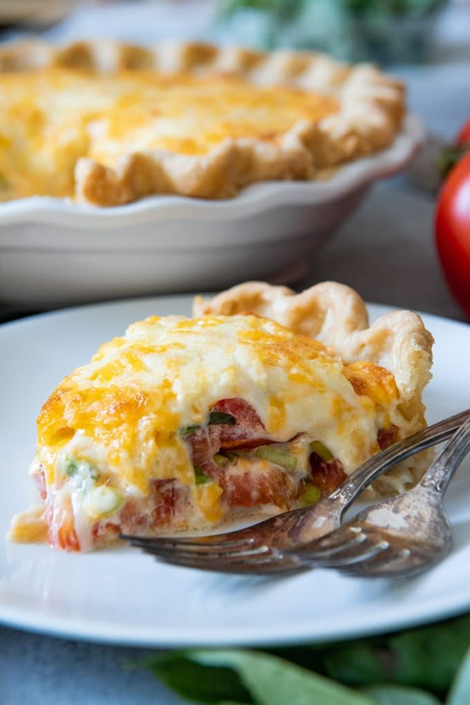 Alabama Tomato Pie This savory Southern Tomato Pie is made with summer-ripe tomatoes, fresh basil leaves, and topped with a tasty cheese & mayo topping!#tomatoes