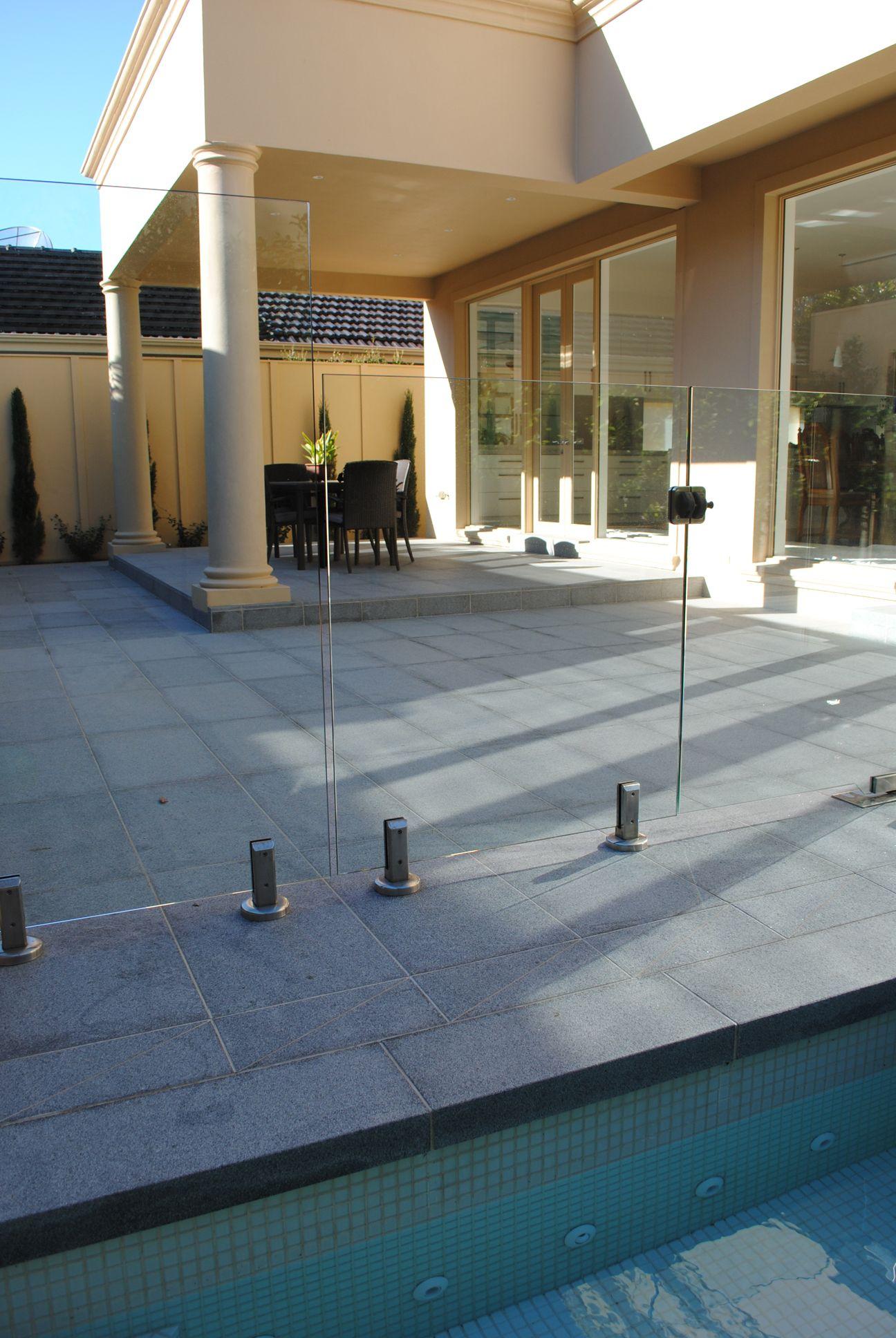 dark grey #granite #pavers around the swimming pool. | granite