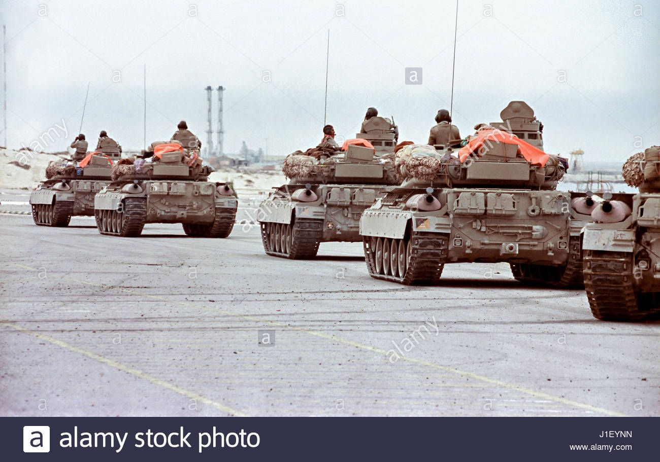 A Qatari tank company holds outside the border city of Khafji for the order to move into the battle against an unexpected Iraqi incursion January 30, 1991 outside Khafji City, Saudi Arabia. The Battle of Khafji was the first major ground engagement of the Gulf War using American airpower and Qatari tank and Saudi Arabian National Guard battalions on the ground.