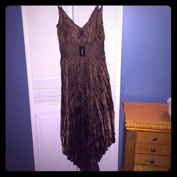 Express crinkle style dress in chocolate brown This dress has a handkerchief hem and pretty braided straps. Super comfortable and easily dressed up or down! Smoke free home. Express Dresses Midi