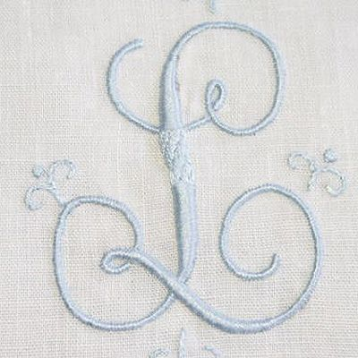 Embroidered initials on table runners
