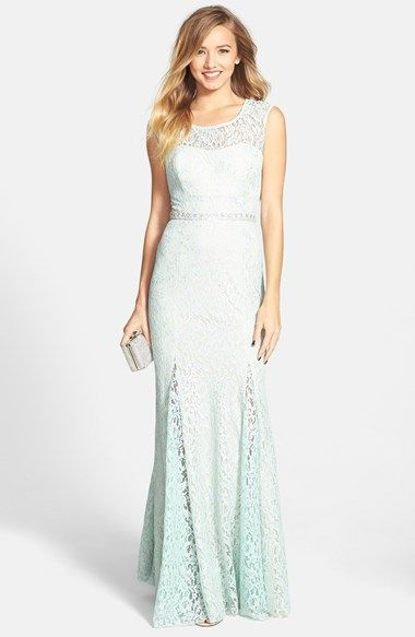 Free shipping and returns on Sequin Hearts Embellished Metallic Lace Gown (Juniors) at Nordstrom.com. Silver-kissed floral lace sweetens a stunning illusion gown cinched by a sparkling embellished ribbon belt that calls attention to the waist before flowing to a godet-flared skirt. The back is left sheer and open to ensure an exit as dramatic as your entr