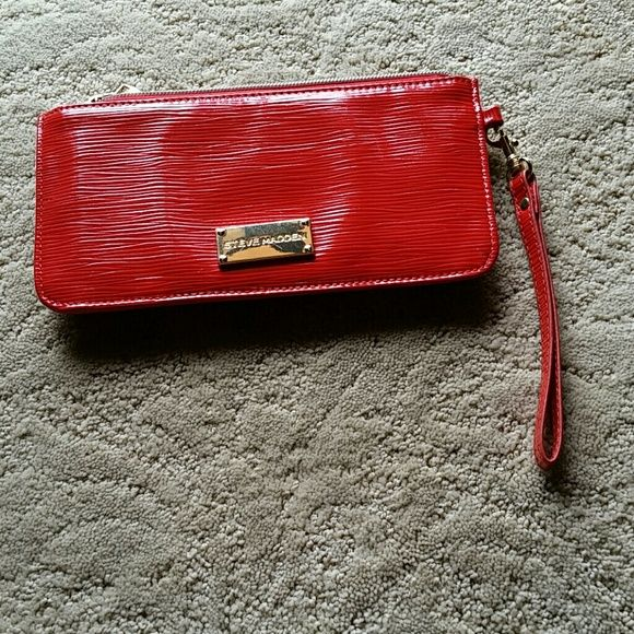 Steve Madden wallet Steve Madden fun orange wallet with plenty of credit card slots and enough room for your cell phone and lip gloss ! Steve Madden Bags Wallets