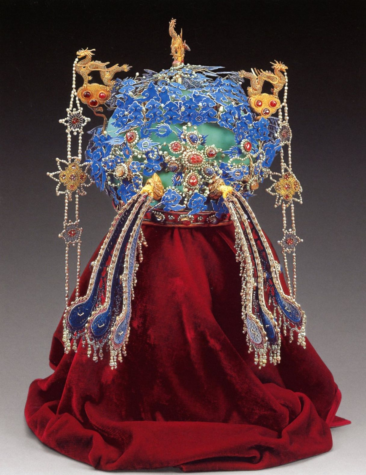 Back side view of the bejeweled 'Phoenix' coronet of Empress Xiaoduanxian (1565 – April 1620), personal name Wang Xijie, a native of Yuyao (modern-day Yuyao, Zhejiang), who was a Ming Dynasty empress of the Wanli Emperor (reigned 19 Jul 1572 – 18 Aug 1620).  Empress Xiaoduanxian is the longest serving empress consort in China. She was the only one of the consorts of Wanli to hold the title of empress during his reign. Her only daughter was Princess Rongchang.