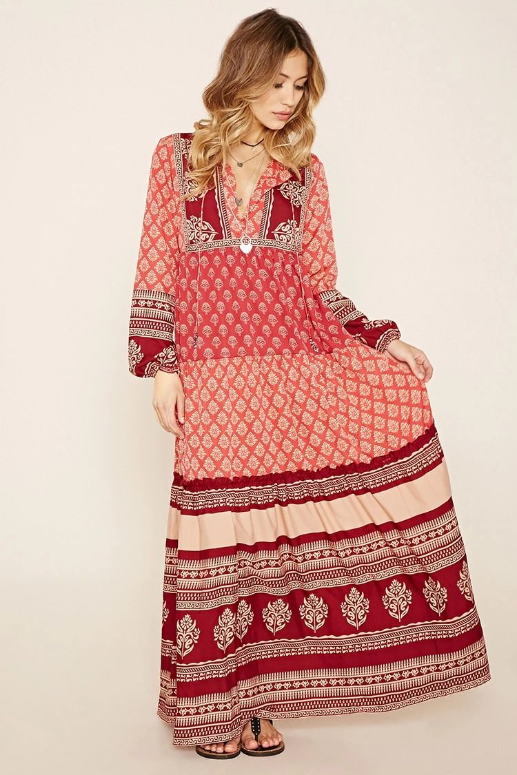 A woven maxi dress by R by Raga™ featuring mixed ornate floral prints, bead-tipped ties accenting the concealed hook-eye closure at its neckline, long sleeves with elasticized cuffs, a tiered skirt, and a partially elasticized waist. #f21brandedshop