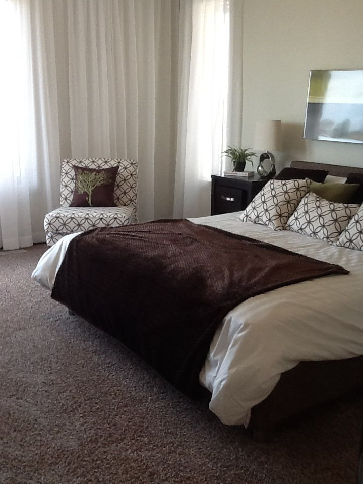 Pretty browns compliment this soothing bedroom.