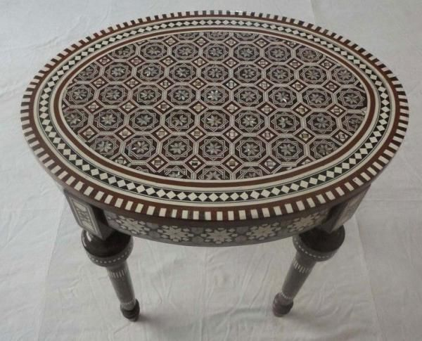 (http://www.ekenoz.com/moroccan-table/egyptian-mother-of-pearl-inlaid-mosaic-oval-coffee-table/)