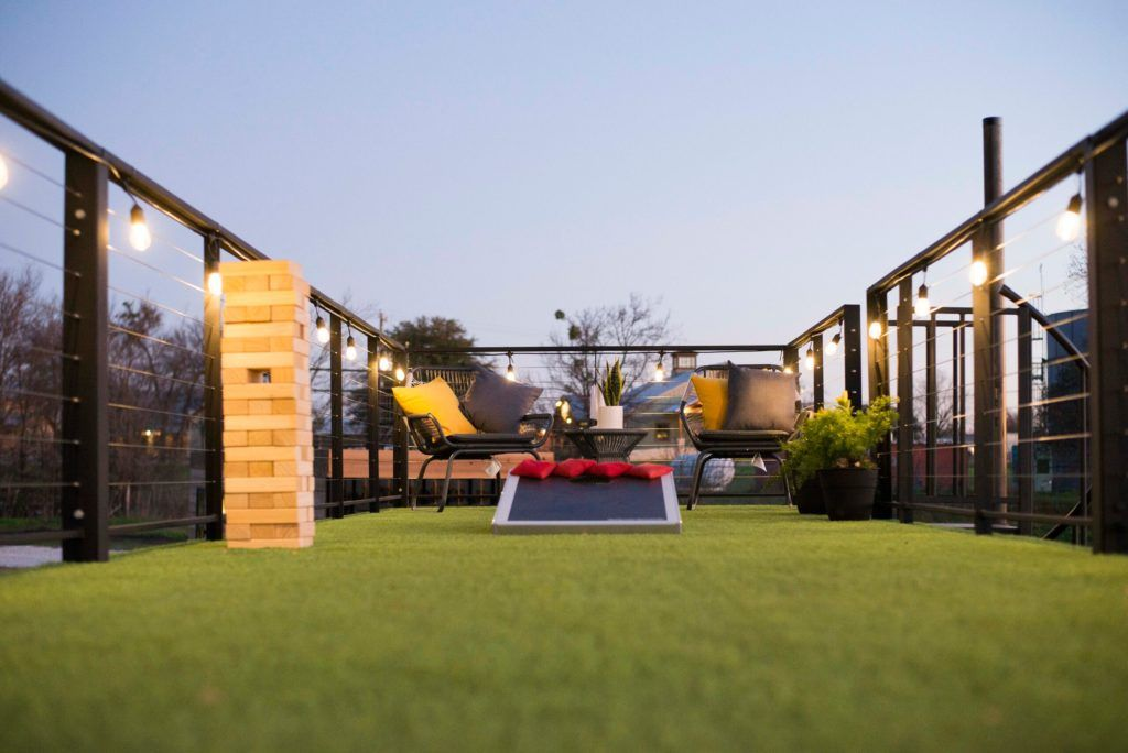 Astroturf Covered Rooftop Deck Container Home From Texas In 2020 Container House Rooftop Deck Astro Turf