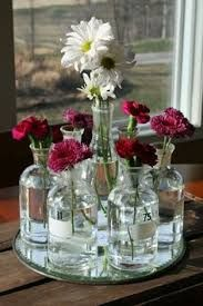 Image result for flowers in bottles