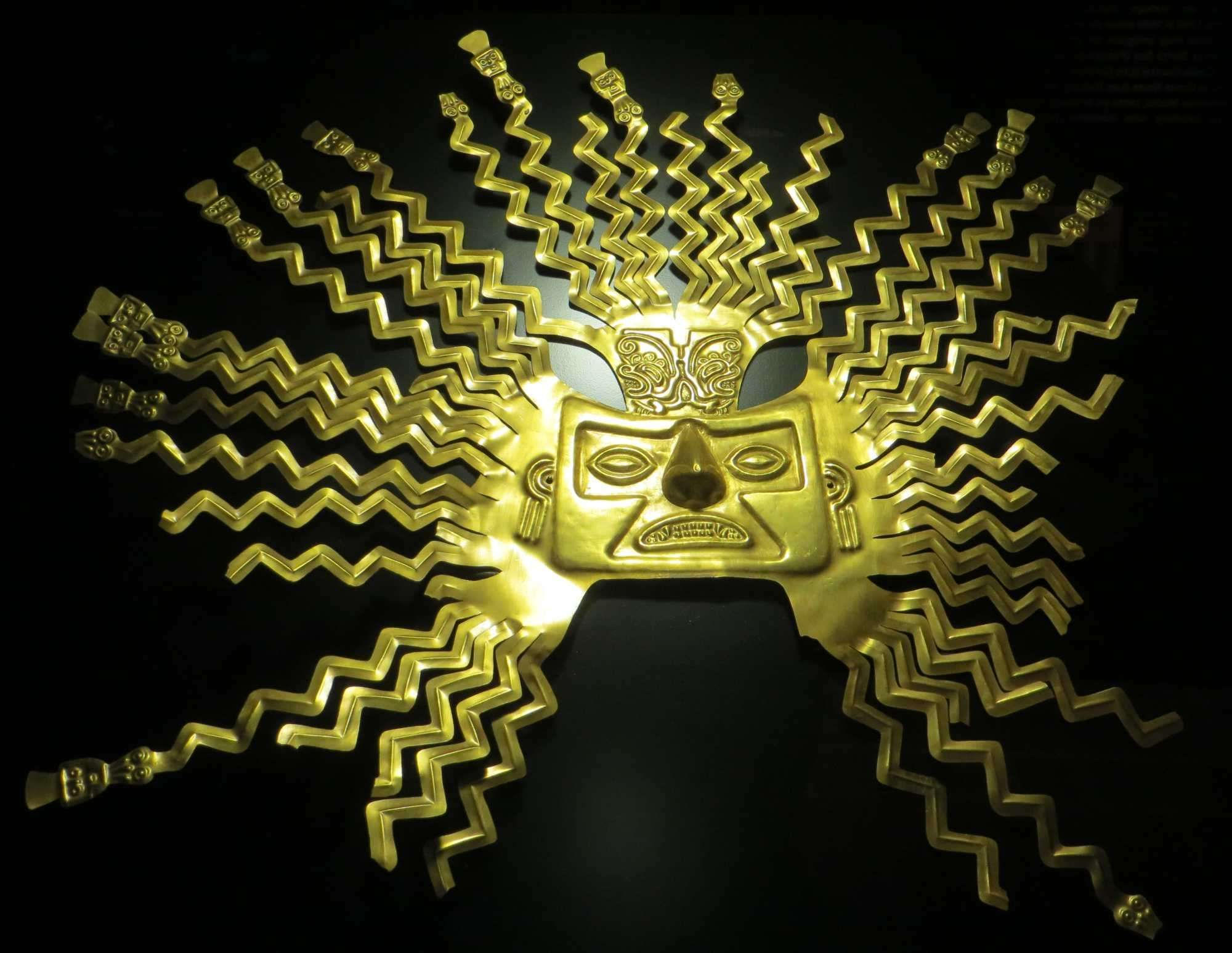 A gold sheet mask representing the sun god Inti from the La Tolita