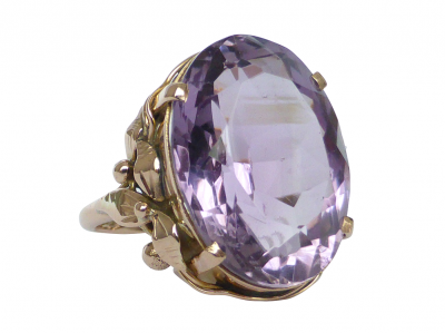 This detailed Antique amethyst ring is a wonderful example of Art Nouveau period with long, sinuous, organic line�surrounding the large�dazzling amethyst gem. This artfully sculpted ring is made from a soft