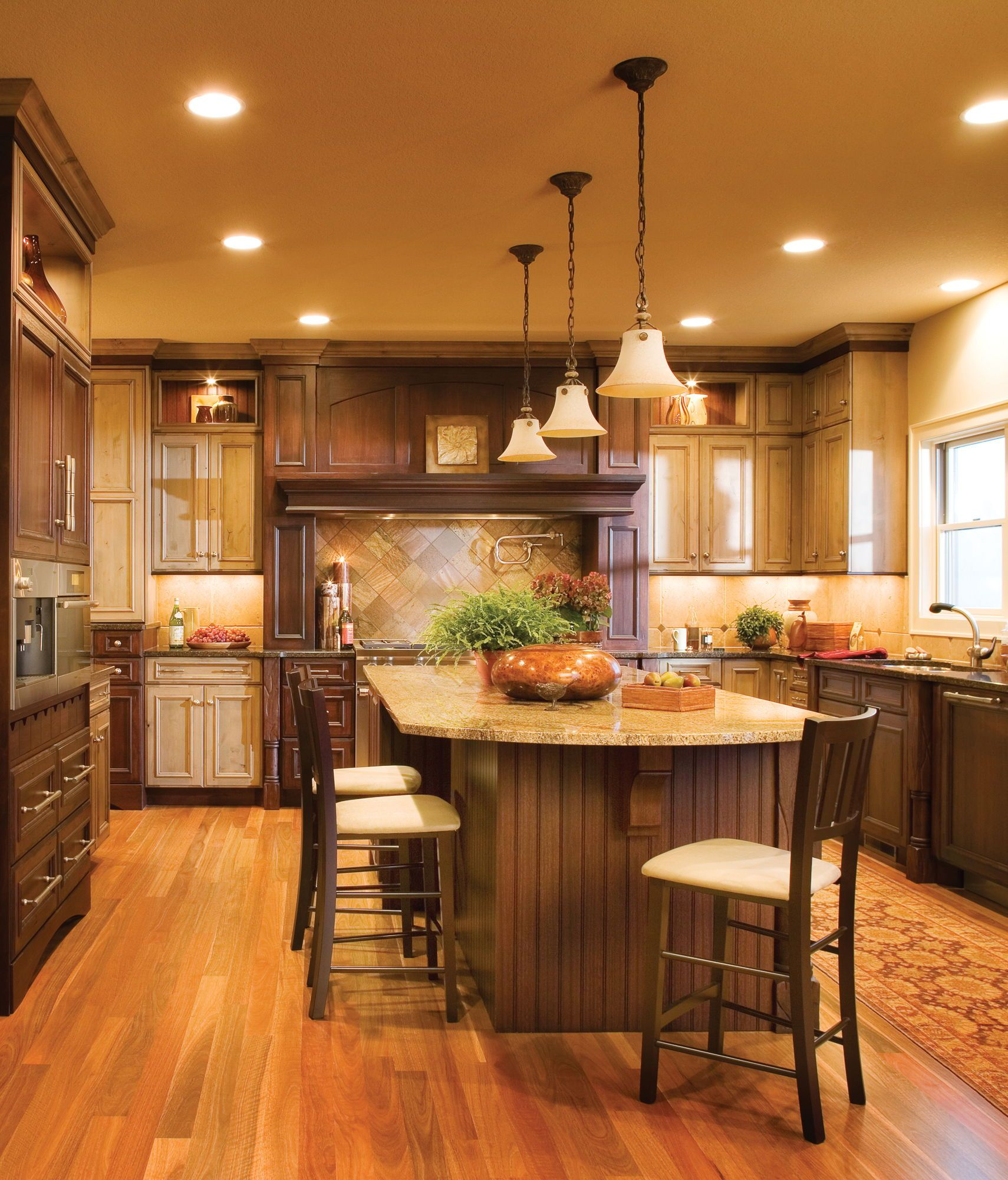 Mix it up with tones of stained cabinets this grand island offers