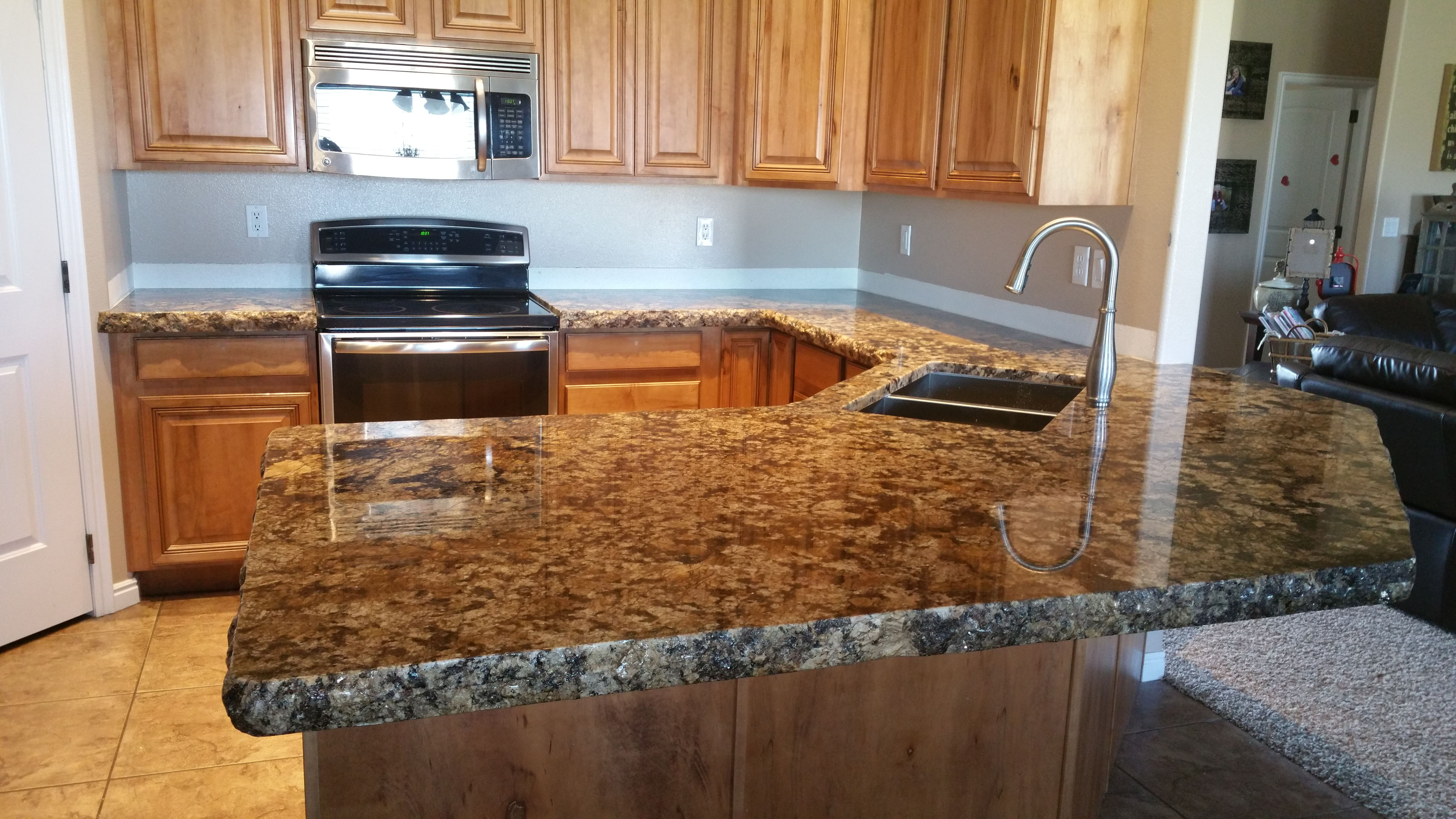 coliseum granite with a 6 cm chipped edge and raised panel style