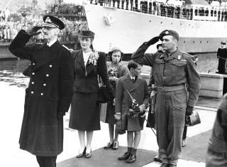 King Haakon, Crown Princess Martha, princess (Astrid or Ragnhild?) and Crown Prince Harald (8 years old) upon return to Norway in 1945.