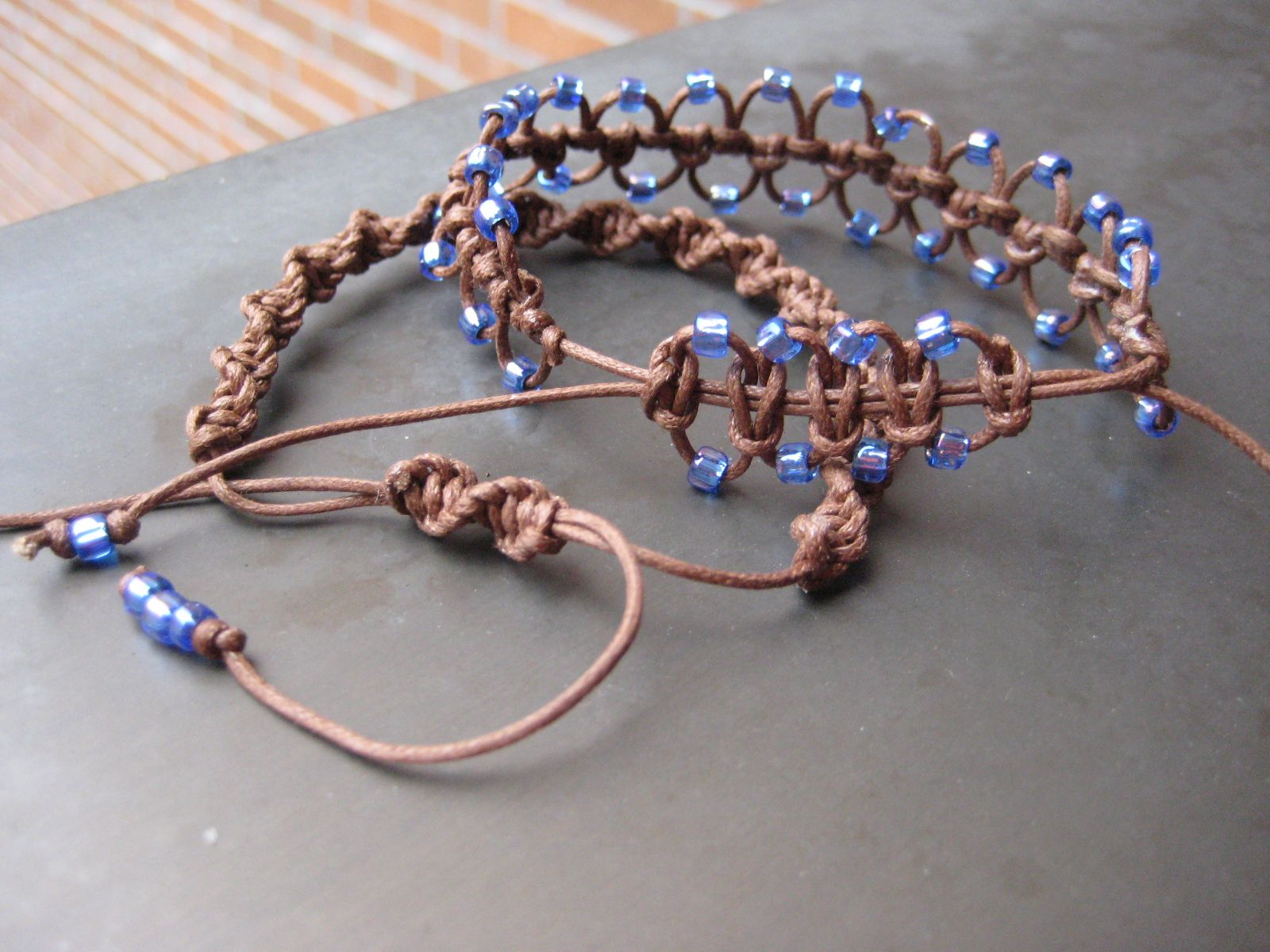 Stacked Brown Macramé Bracelets with Lavender-Blue Beads