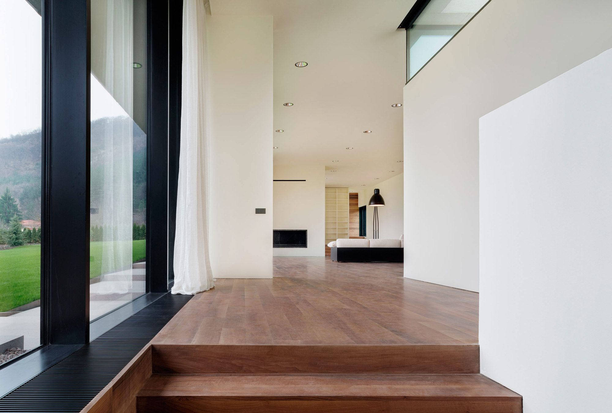 Galería - Casa larga en pendiente ligera / I/O Architects - 3