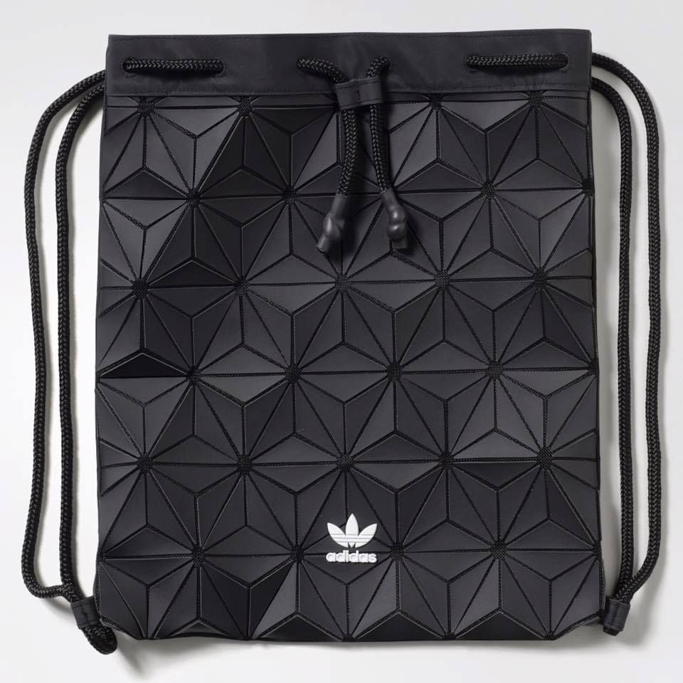 The new adidas Originals Bucket Gym Sack is as eye-catching as it is  versatile. Made in faux leather aa41f2950f