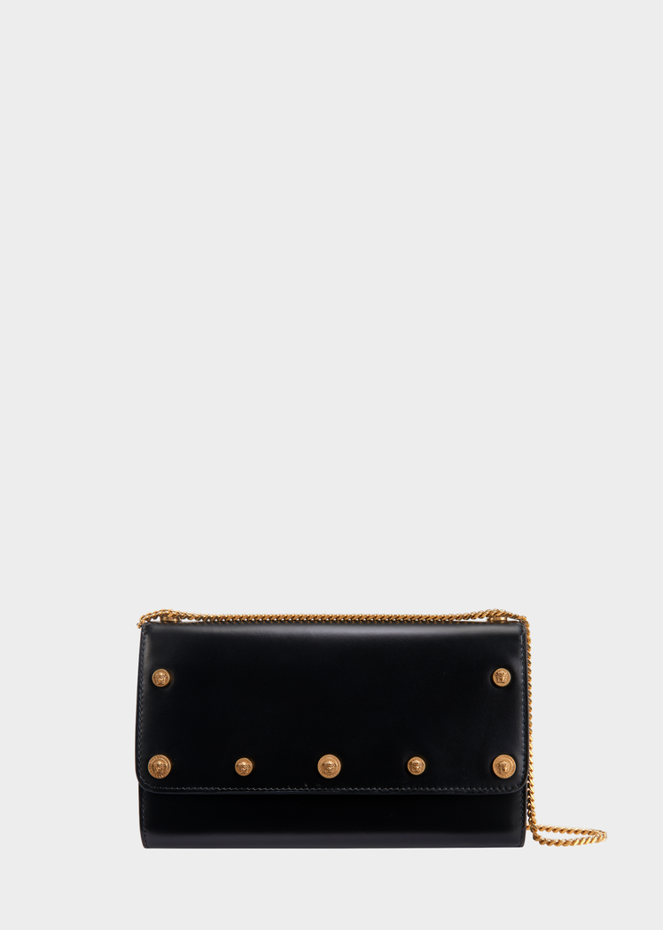 Medusa Stud Evening Bag from Versace Women s Collection. A timeless style  crafted in exceptional quality leather. Featuring a fold over closure and  metal ... dddc7c418c991
