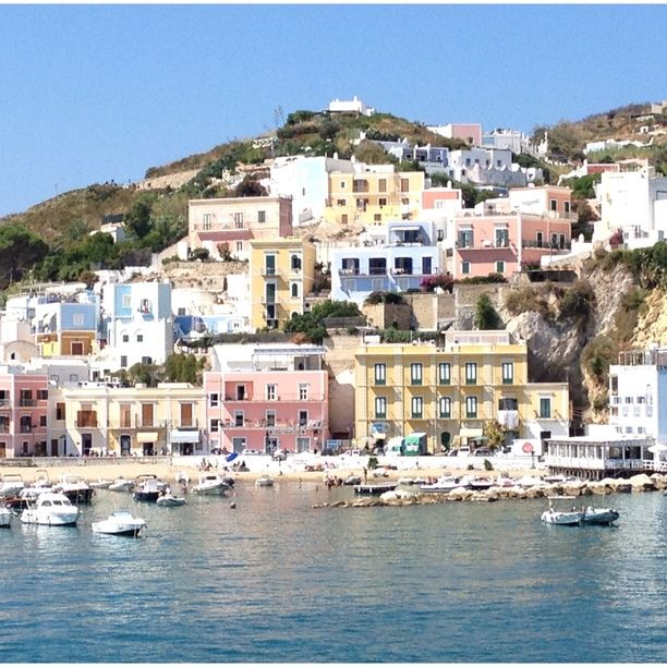 "Discovered by sfascias, ""Arriving into port at Ponza. What a spectacular welcome from the beautifully colored sea and houses. I arrived by ferry from Formia. The ferry ride was 2.5 hours.  I got to Formia by train from Rome (1.5 hours).  The train station at Formia is a short walk to the ferry port. "" at Porto Di Ponza, Ponza, Italy"