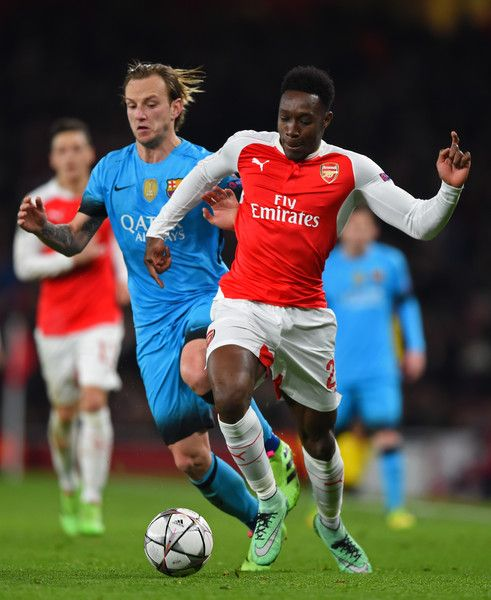 37d944371b5 Danny Welbeck of Arsenal holds off the challenge from Ivan Rakitic of  Barcelona during the UEFA Champions League round of 16