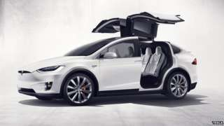 """Image copyright                  Tesla                  Image caption                     The Model X has """"falcon-wing"""" doors that open upwards   Tesla Motors has revealed that supplies of its Model X electric car have been impacted by a shortage of parts meaning delays for some who have ordered them. It blamed its own """"hubris"""" for overloading the Model X with technology. It revealed that it delivered 14,820 cars in the first quarter"""