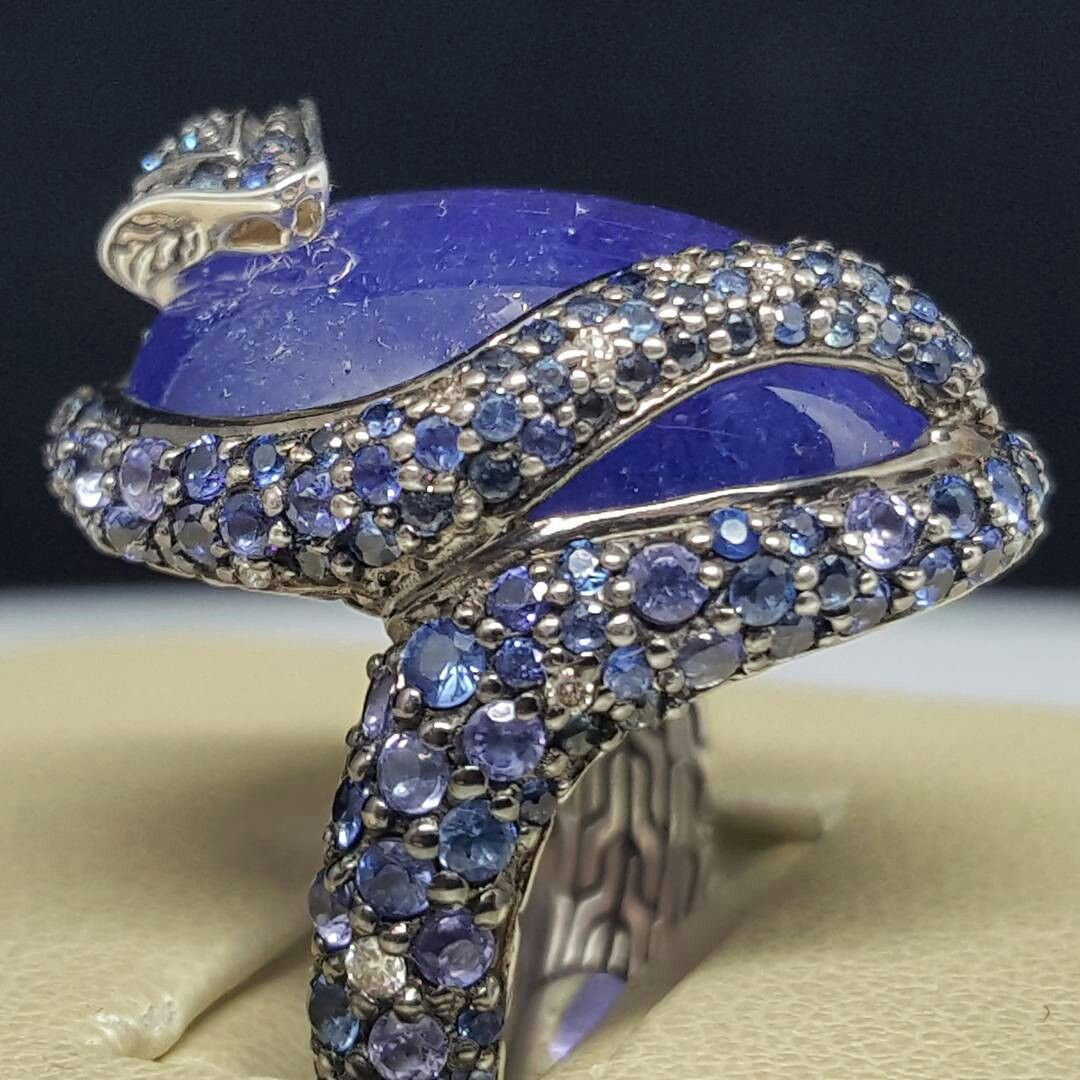 d2f6c8f083b1 From their Legends collection we present this amazing #Cobra coiled around  a #Tanzanite covered in sapphires and diamonds. #JackLewisJewelers