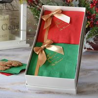 Holiday napkin gift set featuring 100 napkins, 50 in each color with Christmas design and text