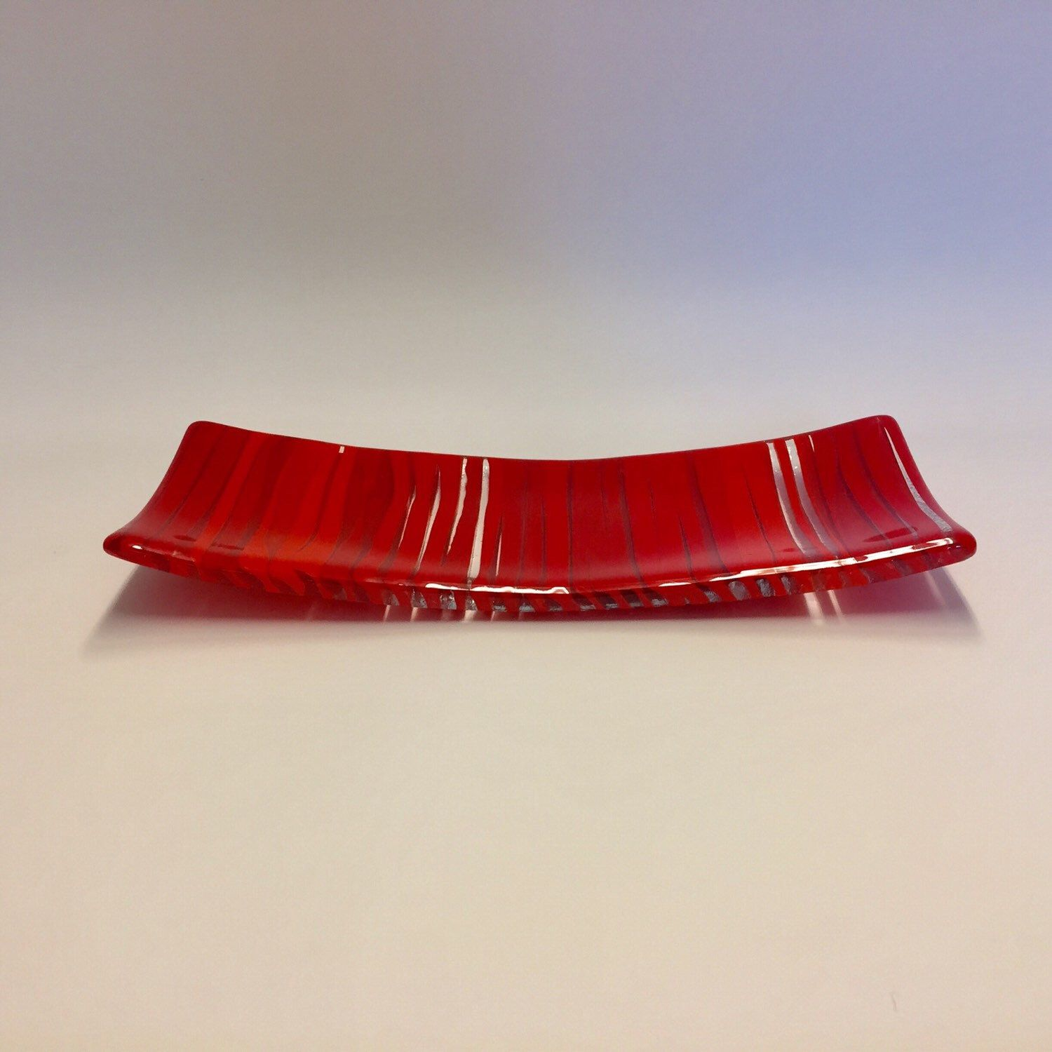 I love this red rectangular platter. It's about 13 x 5 x 0.5 inches. It's functional and decorative. It can make a beautiful Valentine's Day gift!