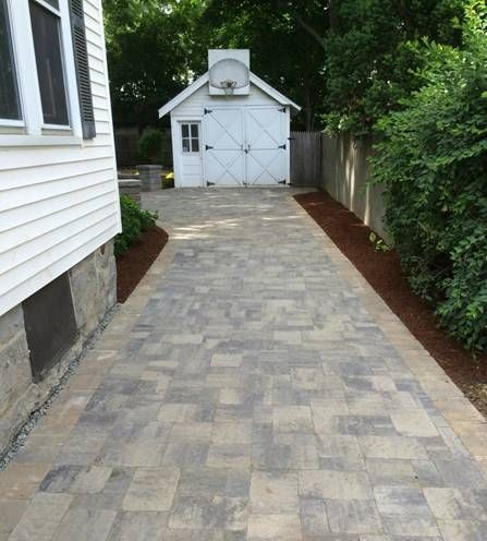 Paver driveway along side the house leading to the garage