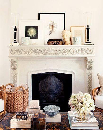 Beautifully layered fireplace, tortoiseshell coffee table, baskets, creams and medium warm woods