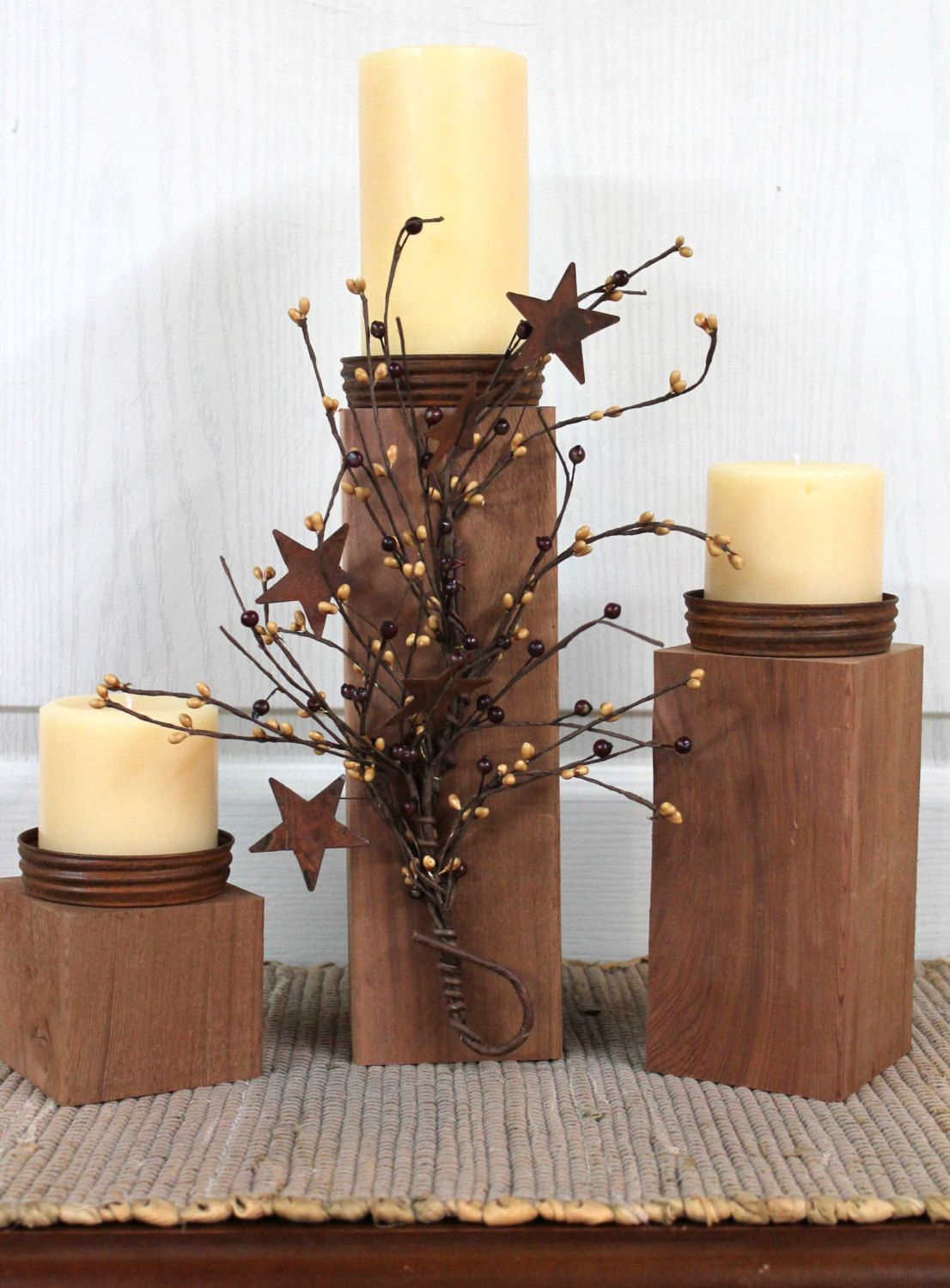 Lovely candle stands using canning lids, via Etsy.