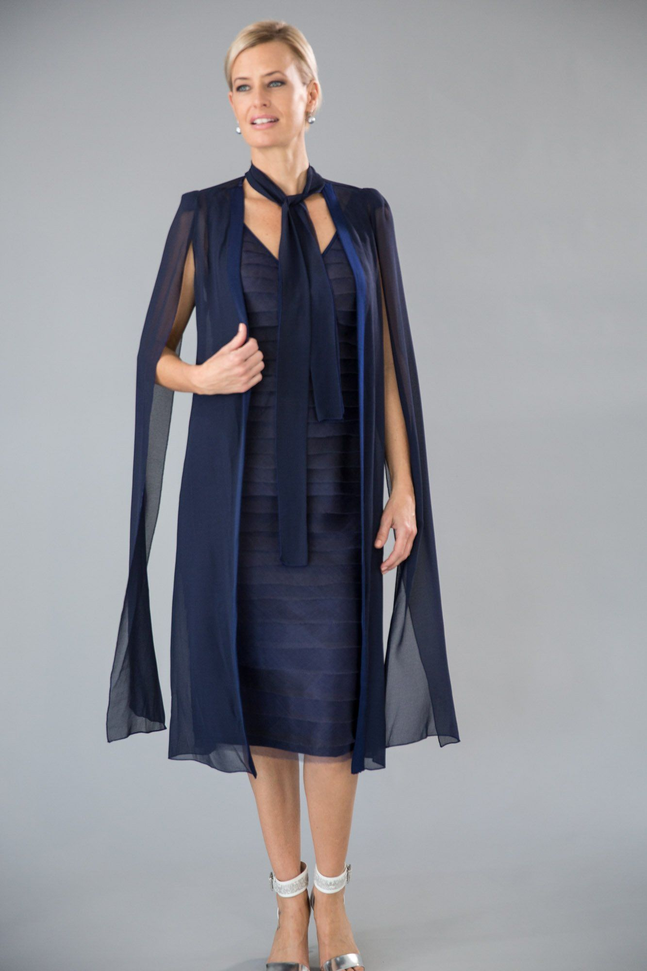 3acfef158779 The Oasis Dress and Coat in navy blue is an elegant option for the modern #