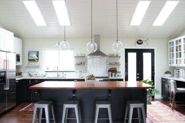 Black And White Ikea Kitchen With Subway Tile Vaulted Ceiling Skylights Black Doors