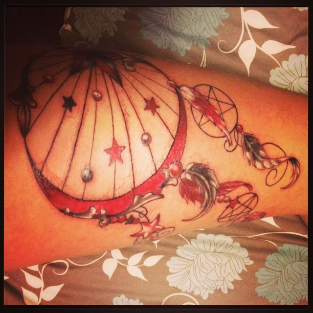 Dreamcatcher tattoo on thigh