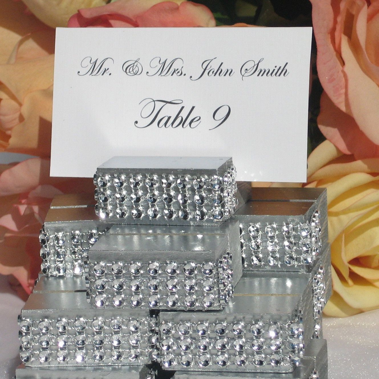 silver jeweled place card holders the holder has been wrapped with a crystal wrap ribbon wedding